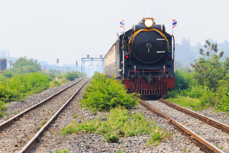 land transportation: thailand locomotive trains running on rialroad track use for vintage land transportation topic Stock Photo
