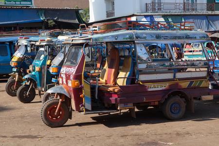 three wheel: LAOS CHAMPASAK-NOV23:laos three wheel vehicle waiting for passenger in champasak morning market  in champasak southern of laos on november 23, 2013  in pakse champasak southern of laos