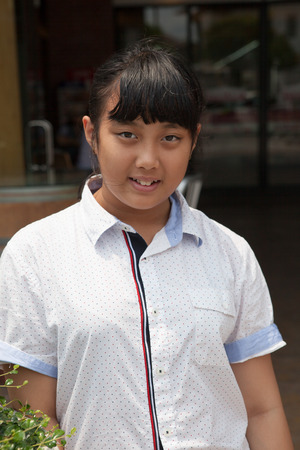 face of asian teen aged standing with smiling face photo