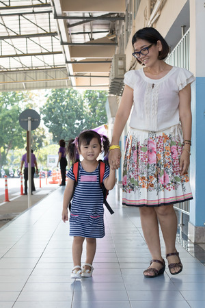 first day of school: children and mother go to school first day use for education ,kid in kindergarten Stock Photo
