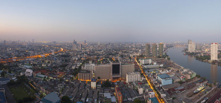 top view from high building roof morning light of bangkok capital of thailand looking to south east direction show glow up light of dawn on ground and over sky photo