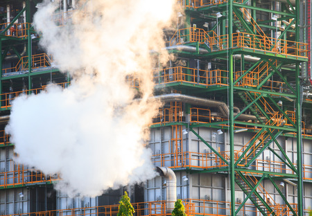 industrail: smoke of pressure flow out from gas tube and metal steel structure in heavy industry estate use for industrial background,backdrop Stock Photo