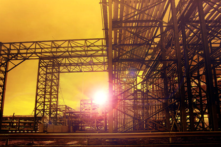 heavy effect: metal structure of industry chemical tube in heavy industrial estate against beautiful sun rising with lens flare effect use for industry background