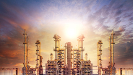 industry: exterior tube of petrochemical plant and oil refinery for produce industrial matterial in heaviy petroleum industry estate against beautiful sun light sky Stock Photo