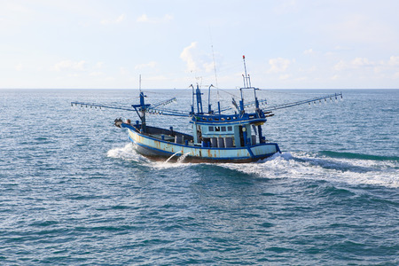 thailand local fishery boat running over blue sea water Stock Photo