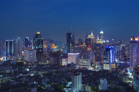 scapes: city scape in heart of bangkok thailand with beautiful lighting of office building and sky scrapper against dusky sky twilight time Stock Photo