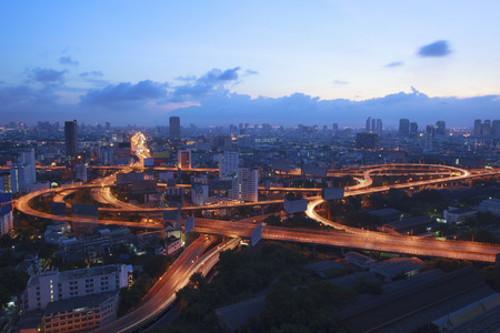 city scape and beautiful traffic light on expressways in heart of bangkok capital of thailand at dawn use for infra structure and land transport in large town Stock Photo