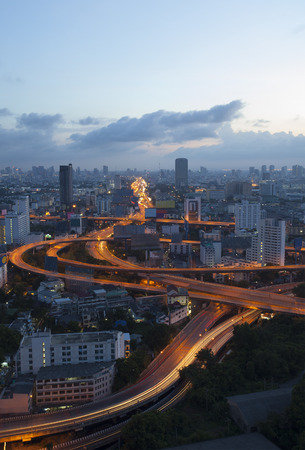 land scape: city scape and beautiful traffic light on expressways in heart of bangkok capital of thailand at dawn use for infra structure and land transport in large town Stock Photo