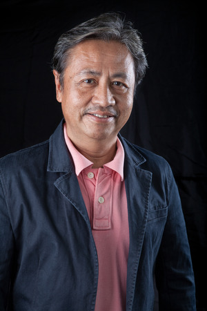 senior asian: portrait head shot of smiling face with happiness emotion senior asian man with studio light Stock Photo