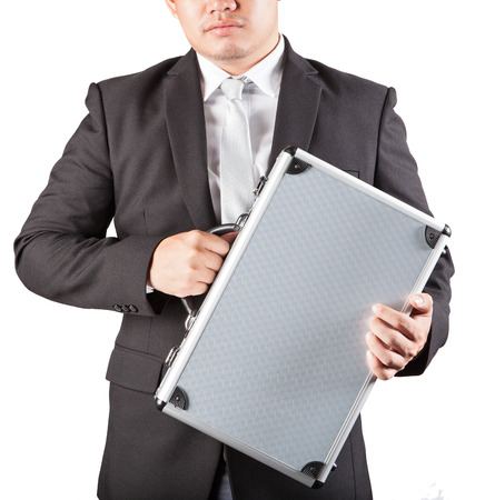 top secret: business man holding metal strong briefcase isolated white background