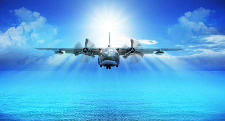 utopia: c123 military plane landing with blue sky sun shine background