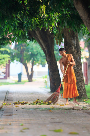 morning routine: AYUTHAYA THAILAND : MARCH 28 : thai buddhist monk daily cleaning temple area in morning routine working in wat niwesthumaprawat important temple in Ayuthaya Provice central of thailand on march28,2015 Editorial