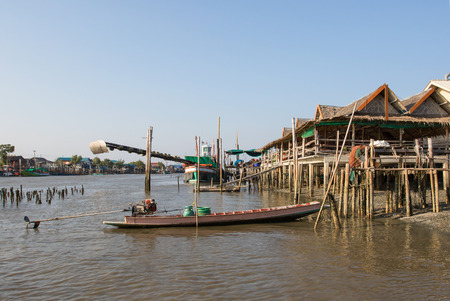 bamboo house: landscape of thailand riverside village in Samutsakorn Province shown fishery boat and bamboo house local thai tradition domestic style Stock Photo