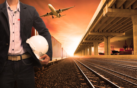 railway transportation: industry container trains on railways track cargo plane flying with land bridge transportation and ship port for land ,air ,ship transportation in logistic business industry ,import export,shipping Stock Photo