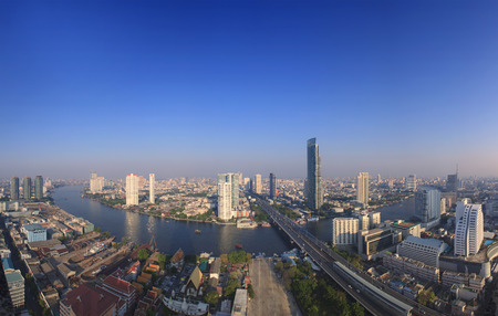 river scape: beautiful city scape from sky scrapper in heart of bangkok capital of thailand with important office building and chaophraya river curve against clear and bright blue sky Stock Photo