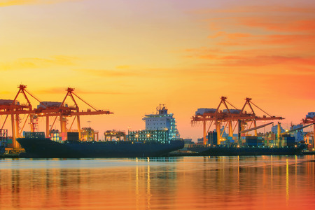 beautiful twilight sky at shipping port use for vessel nautical import and export transport logistic industry Stock Photo