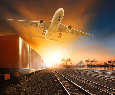 loading cargo: industry container trainst running on railways track plane cargo flying above and ship transport in import export container yard