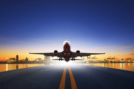 cargo plane take off from airport runways against ship port background use for air transportation and cargo logistic industry ,import ,export business Archivio Fotografico