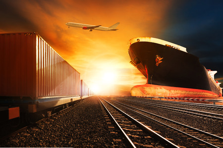container trains ,commercial ship on port freight cargo plane flying above use for logistic and transportation industry background. Stock Photo