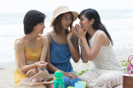three story: portrait group of young beautiful woman friend gossip whispering talking about secret story Stock Photo