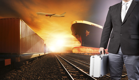 investor business man and container trains ,commercial ship on port freight cargo plane flying above use for logistic and transportation industry background