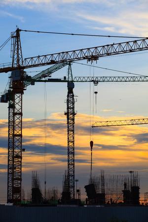 contruction: crane of building construction against beautiful dusky sky