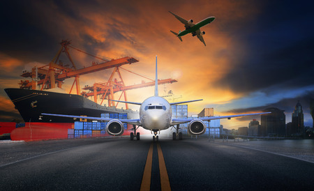 ship loading container in import - export pier and air cargo plane approach in airport use for transport and freight logistic business industry background Stock Photo
