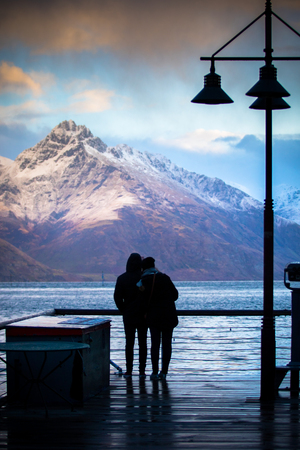 wakatipu: silhouette of couples love standing in wakatipu lake view point in queen town south island new zealand at beautiful scenic