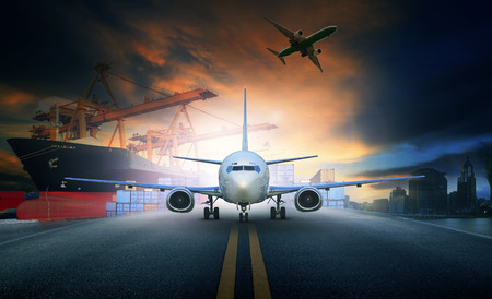 ship loading container in import - export pier and air cargo plane approach in airport use for transport and freight logistic business industry background Archivio Fotografico