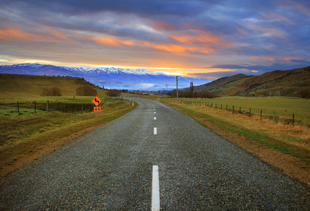 land scape: beautiful asphalt road and land scape rural country farm south island new zealand