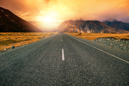 beautiful land scape of asphalt highways perspective to sun set mountain use for multipurpose natural background
