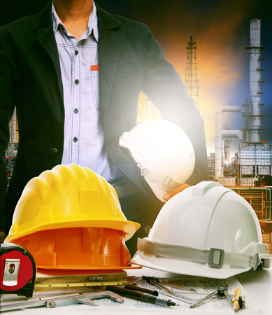 energy use: working table of engineer in oil refinery industry plant use for heavy industry and energy manufacturing in industrial business Stock Photo