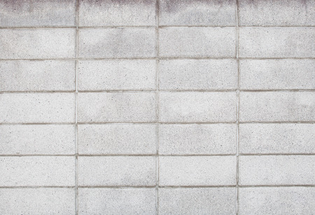symetry: real photo of seamless block wall with pattern line use as background,backdrop and construction texture