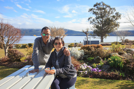 anau: thai people take a photograph with happiness emotion at te anau lake fiord land national park south island new zealand Stock Photo