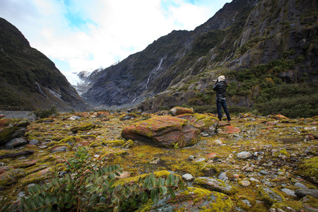 josef: photographer take a photograph in franz josef glacier trail important traveling destination in south island new zealand