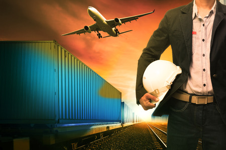 infra construction: industry container trains running on railways track  cargo plane flying with land bridge transportation over ship port use for land ,air and ship transportation in logistic business industry ,import expoert shipping service