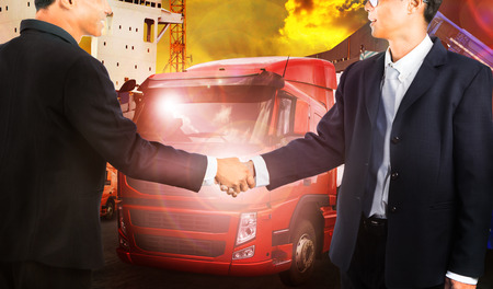 shake: twon business man shake hand with successful joint venture business corporate team solution in transportation industry Stock Photo
