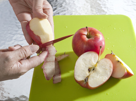 sliced: hand sliced apples peel in kitchen room Stock Photo