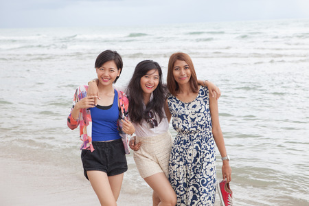 asian group: portrait of young beautiful asian woman friend relaxing happy emotion on sea beach vacation holiday Stock Photo