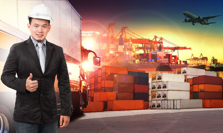 comercial: business man and comercial ship with container on port use for import ,export and shipping logistic industry service and air cargo