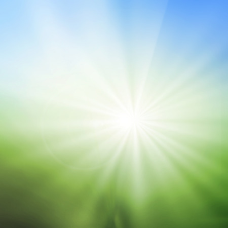 radial background: abstract blur background of green grass field and blue sky above