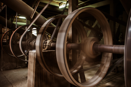 ancient tradition: old heavy machine wheel working by hot steam in ancient tradition factory Foto de archivo