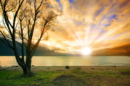 land scape: land scape of sun rising sky behind natural lake and snow mountain  in new zealand Stock Photo