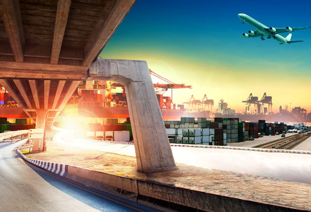 land transport: land transport run into shipping port and container dock with freight cargo plane flying above