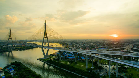 river scape: aerial view of bhumiphol bridge crossing chaopraya river important modern landmark of bangkok thailand capital Stock Photo