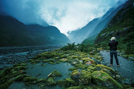 franz josef: photographer take a photo of franz josef glacier