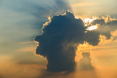 body scape: reality dramatic human head cloud on dusky sky Stock Photo