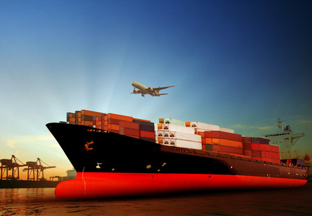 cargo transport: container ship in import,export port against beautiful morning light of loading ship yard use for freight and cargo shipping vessel transport