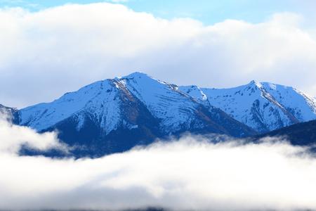 fiordland: snow mountain peak over te anau lake fiordland national park south island new zealand natural traveling destination