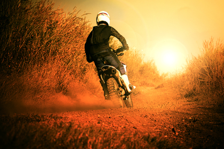 a hobby: man riding motorcycle in motorcross track use for people activities and leisure ,traveling